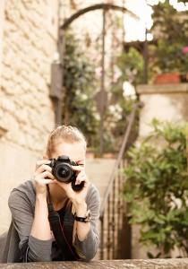 Young female traveler photographer